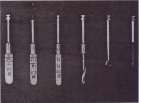 FIG. 14-48 Configuration' of drills differs from system to system. All cylindrical implant systems use progression of drills of increasing diameter to produce implant recipient site. This drill system is part of IMZ Sy~tem. (Courtesy Steti-Os», Yorba-Linda, Calif.)